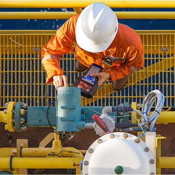 oil production facilities, men in the uniform